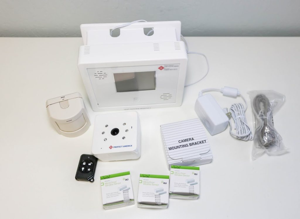 DIY install home security equipment - motion detector, door and window sensors, video security camera, simon video touchscreen