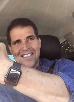 Customer smiling while wearing an Apple Watch