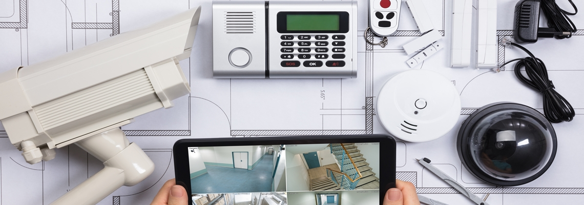 home security system equipment, camera, keychain remote, sensors, monitor screen, wall base station
