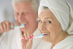 Seniors brushing teeth, oral health