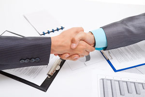 Amazon, business deals, shaking hands