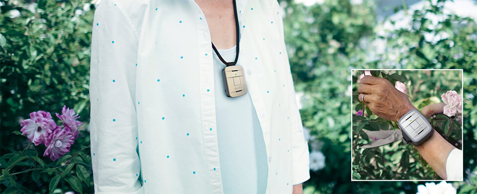 GreatCall Lively Alert, senior wearing medical alert system device outside